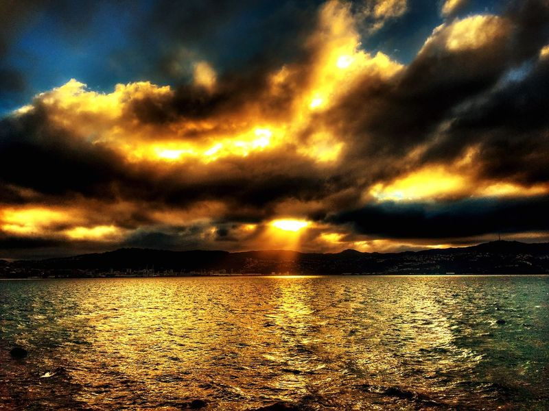 Sunset sea view dramatic clouds light ray Scenics Beauty In Nature Tranquility Sky Cloud - Sky Nature Sunset Tranquil Scene Water Sea Rippled No People Outdoors Dramatic Sky Idyllic Reflection Sunlight Waterfront Mountain Day