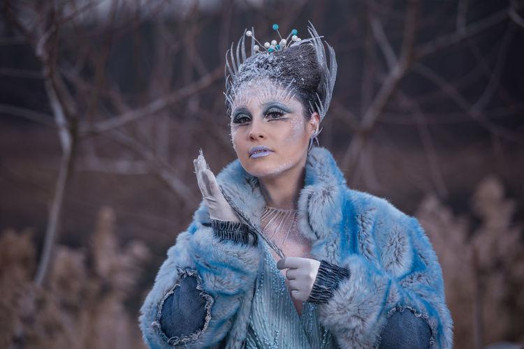 Portrait of woman wearing mask standing in winter