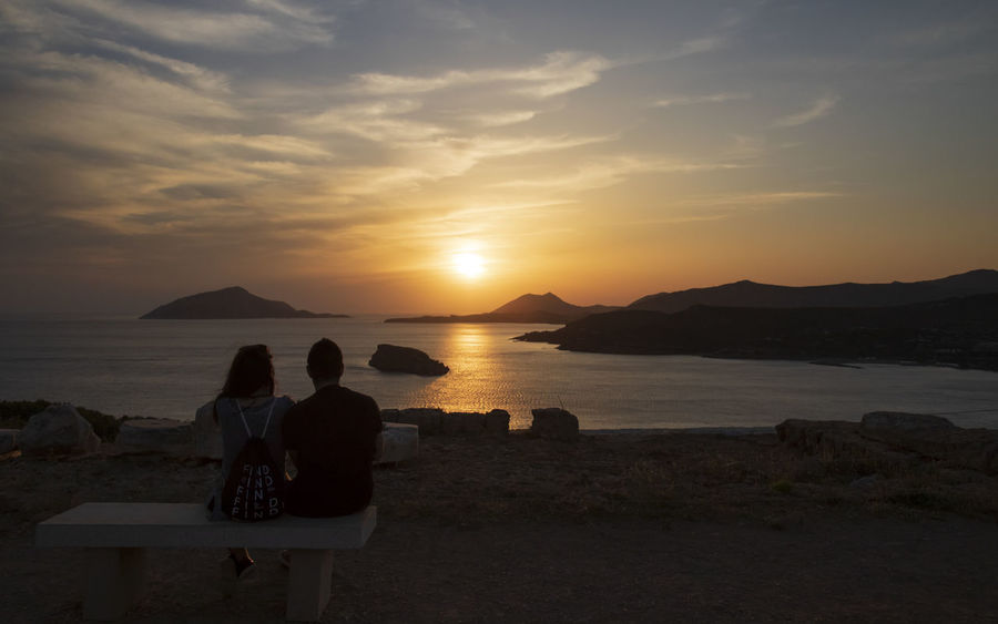 Couple watching the sunset in Greece (Cape Sounion) Friends Friendship Bonding Tranquility Staring At The Sun Watching The Sunset Lover Couple Emotional Cape Sounion Greece Beauty In Nature Cloud - Sky Sea Love Togetherness Arm Around Outdoors Emotion Positive Emotion Couple - Relationship Real People Two People Sunset A New Beginning