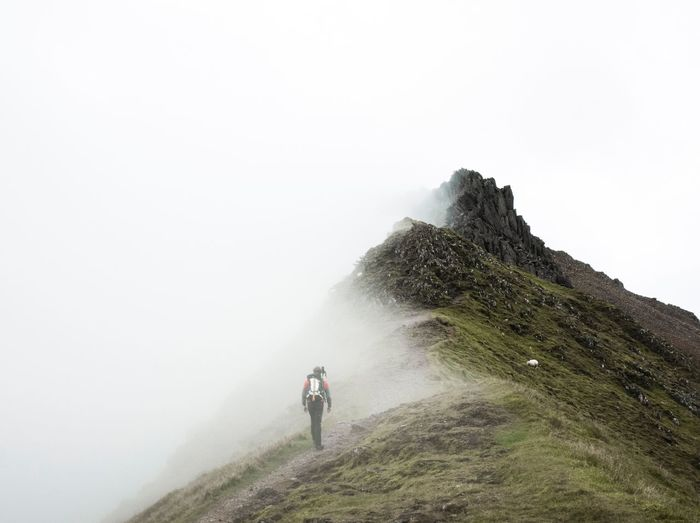 Lost In The Landscape Fog Nature Adventure Mountain Foggy Hiking Beauty In Nature Landscape Travel Rear View Backpack Scenics Walking disappear