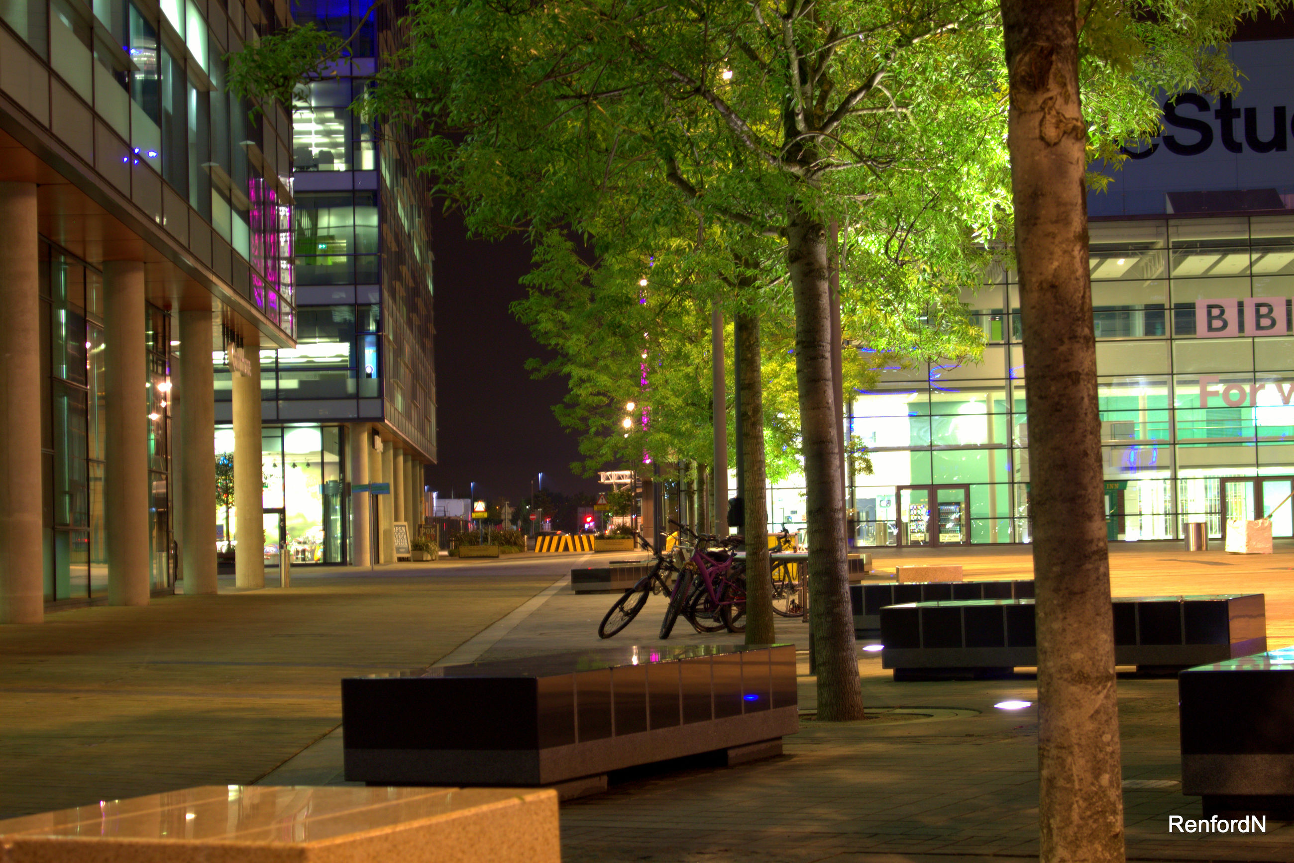 building exterior, built structure, architecture, city, tree, incidental people, city life, illuminated, residential building, residential structure, street, men, outdoors, table, night, building, person, restaurant