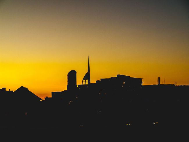 Sunset Silhouette City Architecture Cityscape Sky Built Structure Travel Destinations No People Urban Skyline Tower Building Exterior Romantic Sky Beauty In Nature Television Industry Skyscraper Outdoors Scenics Nature Place Of Worship