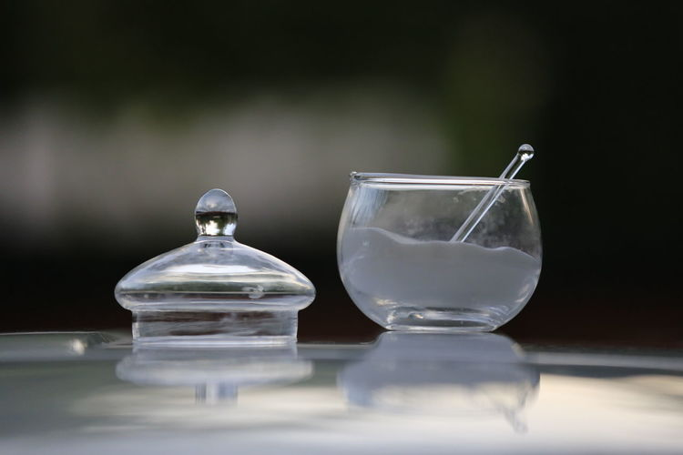 Close-Up Of Sugar In Glass Container On Table
