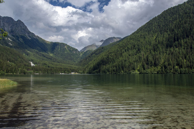 Anterselva Lake Beauty In Nature Cloud - Sky Environment Forest Lake Landscape Mountain Mountain Range Nature No People Plant Range Reflection Scenics - Nature Sky Tranquil Scene Tranquility Tree Water Waterfront