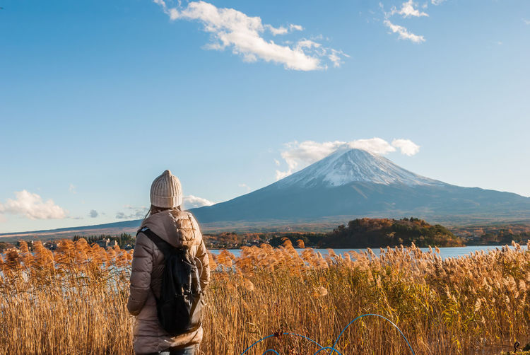 girl with Mt. Fuji background Females Grass Mount FuJi Tourist Tourist Attraction  Travel Beauty In Nature Cloud - Sky Day Field Girl Landscape Mountain Nature One Person Outdoors People Real People Rear View Scenics Sky Tranquil Scene Tranquility Travel Destinations Women