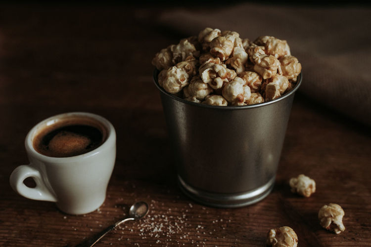 Espresso and popcorn Espresso Coffee Popcorn Food And Drink Food Table Cup Freshness Coffee - Drink Wood - Material Indoors  Drink Still Life No People Close-up Refreshment Coffee Cup Healthy Eating Indulgence Temptation