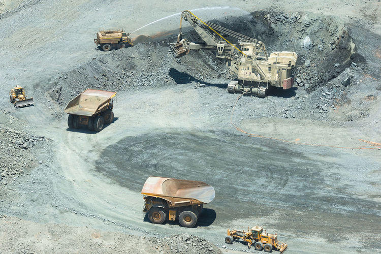 Electric rope shovel loading a dump trucks at a copper mine in chile