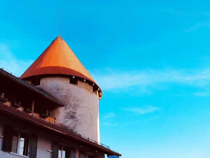 Low angle view of church against blue sky at slovenia in europe