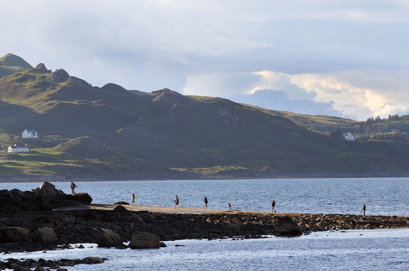 Family returning to the car - Staffin, Isle of Skye Cloud Cloudy Coast Coastline Day Family Highlands Holiday Idyllic Mountain Non-urban Scene Outdoors Remote Scenics Scotland 💕 Sea Sky Skye Travel Destinations Vacations Water