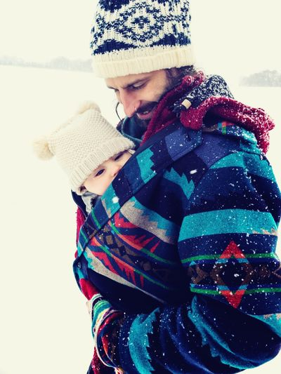 father and baby in winter outdoors Smiling Happy People Winter Dad Hike Active Lifestyle  Warm Clothing Snowstorm Snowfall Father Care Baby Baby Carriage Winter Clothing Hat Warm Clothing Cold Temperature One Person Knit Hat Snow Real People Child Childhood Nature