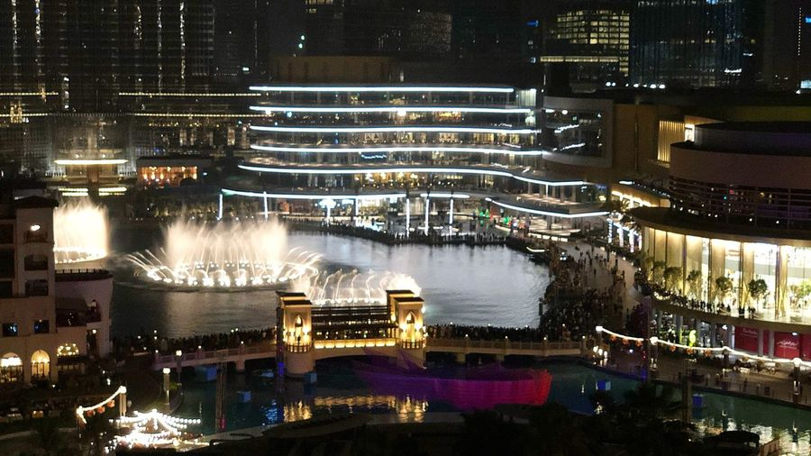 Nightlife Night Dubai Water Fountain Downtown Dubai Water Fountain Illuminated Architecture Night Built Structure Building Exterior City Water High Angle View Building Outdoors Glowing City Life The Traveler - 2018 EyeEm Awards
