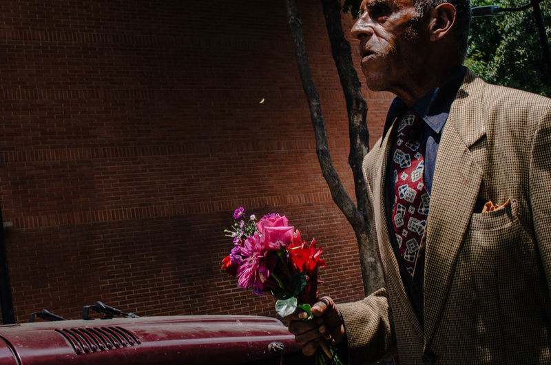 Vintage man with roses. Flower Flowering Plant Plant Well-dressed Suit One Person Bouquet Rose - Flower Flower Arrangement Indoors  Rosé Men Formalwear Adult Business Nature Holding Full Suit Front View Menswear Flower Head EyeEm Best Shots EyeEm Selects Street Photography Streetphotography The Art Of Street Photography The Street Photographer - 2019 EyeEm Awards