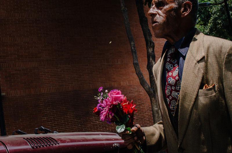Man holding rose bouquet
