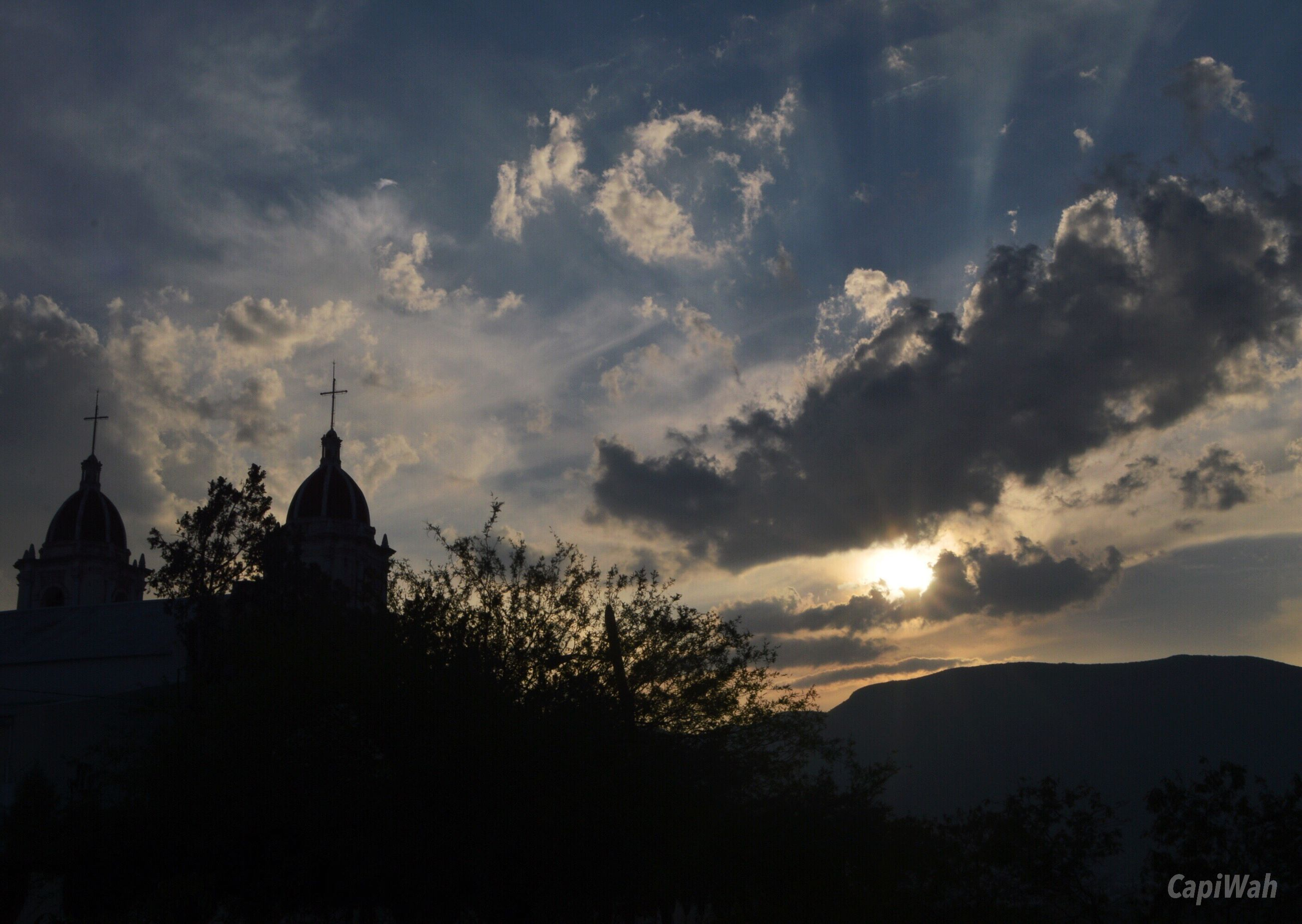 silhouette, building exterior, sky, sunset, architecture, built structure, cloud - sky, tree, religion, place of worship, spirituality, scenics, mountain, beauty in nature, church, dusk, nature, cloudy, cloud