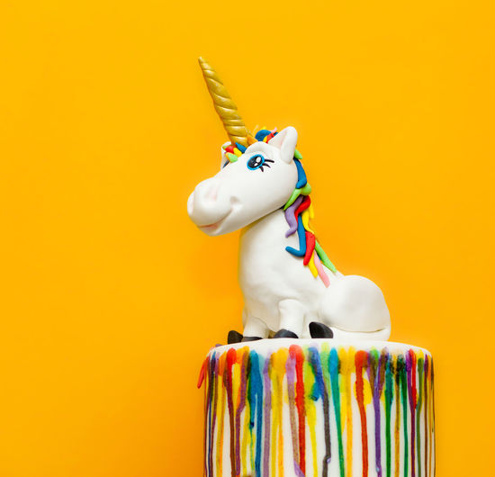 Unicorn cake topper made with in sugar paste or Fondant. Unicorn Unıcorn Bakery Cake Topper Close-up Clown Copy Space. Day Fondant  Indoors  Multi Colored No People Studio Shot Sugar Paste Yellow