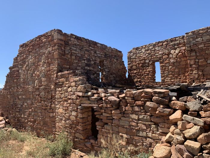 Old ruin building against clear sky