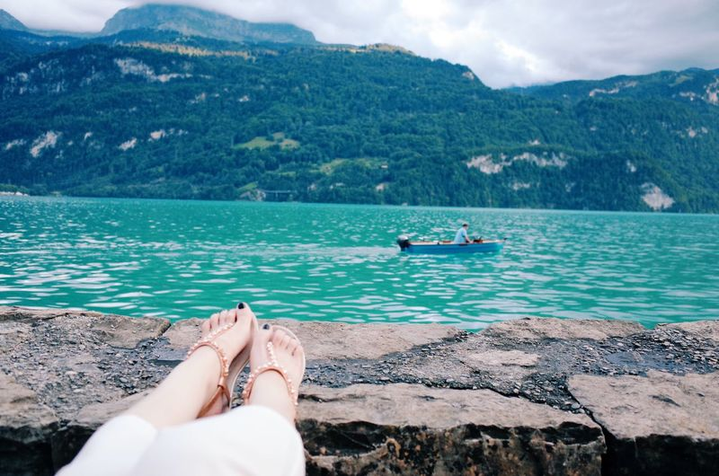 Low Section Human Leg Water Human Foot Mountain Barefoot Real People One Person Personal Perspective Sea Beauty In Nature Women Relaxation Nature Scenics Day Lifestyles Outdoors Human Body Part Beach Switzerland Lake Trip Relaxing Summer