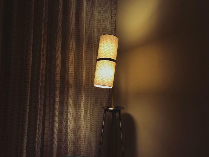 Close-up of illuminated lamp on wall at home
