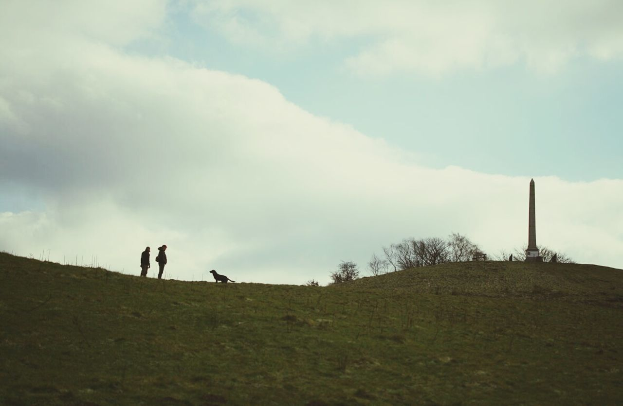 two people, sky, real people, field, nature, walking, day, men, leisure activity, landscape, outdoors, togetherness, standing, scenics, grass, full length, beauty in nature, mammal, people