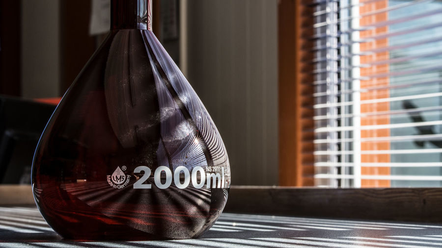 Architecture Bag Built Structure Close-up Communication Day Focus On Foreground Glass - Material Hanging Indoors  No People Sport Still Life Table Text Transparent Western Script Window Wood - Material