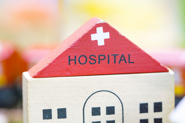 hospital toy model preschool indoor playground (Play set Educational toys) Close-up Focus On Foreground Red Text No People Day Box Western Script Shape Christmas Outdoors Communication Sign Still Life Capital Letter Architecture Celebration Container Box - Container Hospital Wooden Toy Block