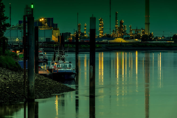 refinery Elbe River Hamburg Harbor Power Plant Refinery Water Reflections Artifical Light Boat Ship Shore Shore Line Pillar Signal Light Green Light Night Lights Nightphotography Stone Pier Stake Pale Water Nautical Vessel Illuminated Reflection Architecture Night Waterfront Transportation Built Structure Industry Building Exterior Harbor No People Nature Sky Mode Of Transportation Outdoors Sea