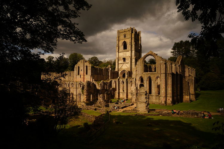 Fountains Abbey looking eerie. Ancient Ancient Civilization Architecture Building Exterior Built Structure Cloud - Sky Damaged Day Fountains Abbey Yorkshire History Nature No People Old Ruin Outdoors Place Of Worship Religion Sky Spirituality The Past Travel Destinations Tree