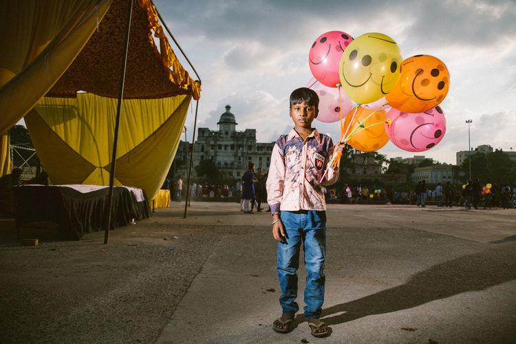 Full length of a man holding balloons