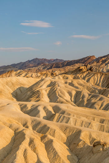 Zabriskie Point in Death Valley, with evening light Death Valley Zabriskie Point Arid Climate Armagosa Range Beauty In Nature Climate Day Desert Environment Eroded Formation Idyllic Land Landscape Nature No People Non-urban Scene Outdoors Physical Geography Remote Rolling Landscape Scenics - Nature Sky Tranquil Scene Tranquility