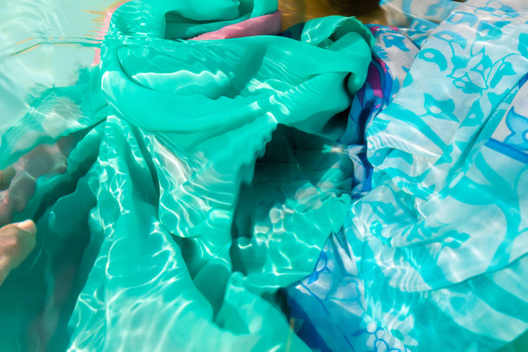 Cropped image of woman with scarf in swimming pool