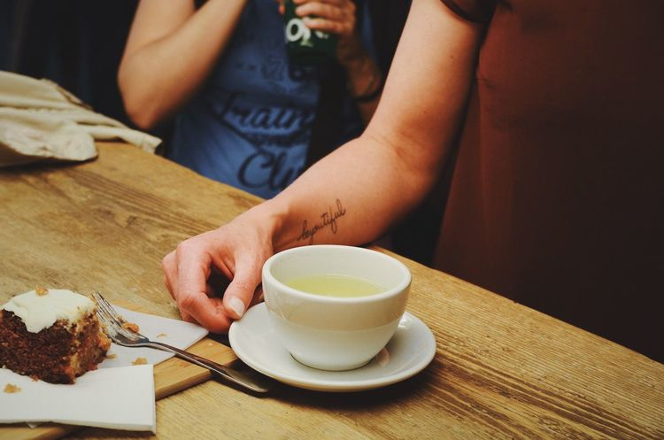 Beautiful Beautiful Close-up Coffee Coffee Cup Cup Drink Food And Drink Healthy Lifestyle Holding Home Human Body Part Human Hand Indoors  Occupation One Person Part Of Preparation  Refreshment Spoon Table Tatoo Temptation