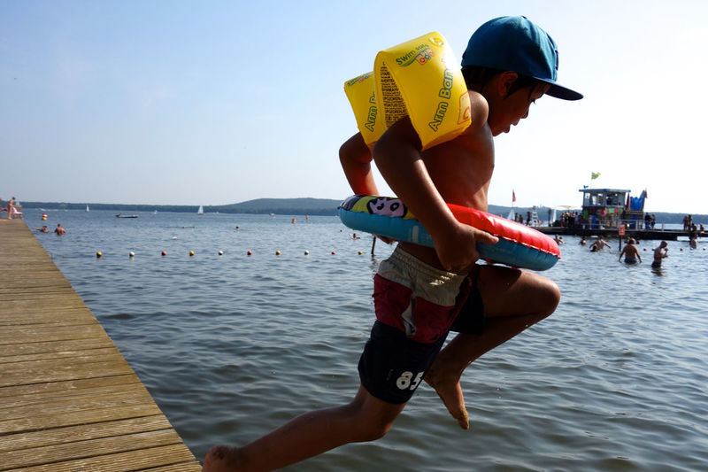 Woman jumping in sea