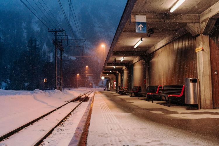 Illuminated railroad station platform during winter