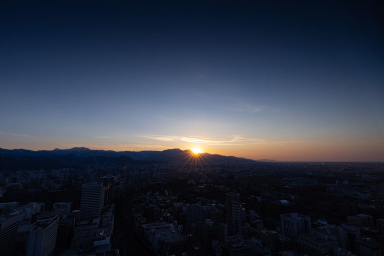 Sky Cityscape City Building Exterior Architecture Built Structure Crowd Crowded Residential District Sunset Nature Building Clear Sky Sunlight High Angle View Sun Outdoors Copy Space Aerial View Office Building Exterior Skyscraper TOWNSCAPE Settlement Sapporo Hokkaido Japan