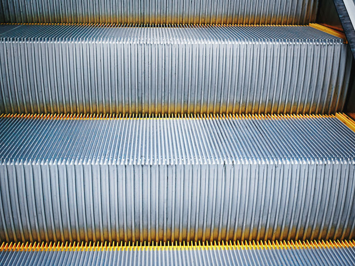 Full frame background of close-up escalator stairs