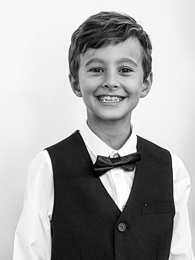 Looking At Camera Child Portrait Smiling Old-fashioned Bow Tie Retro Styled Cheerful Suit Blond Hair Childhood People Indoors  Student Boys Happiness Children Only Formalwear