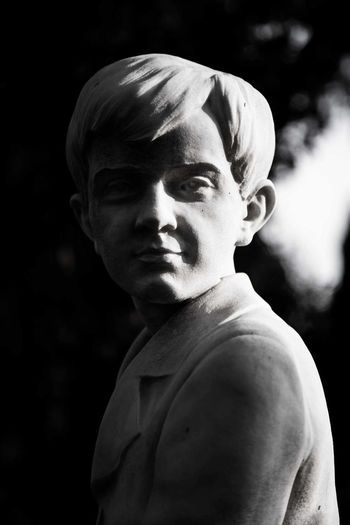 Statue Statues And Monuments Cimitero Monumentale Blackandwhite Black And White Photography Grave Graves Gravestone Boy Portrait Athlete Sportsman Headshot Black Background Classical Music Muscular Build Men Camouflage Clothing Army Chiaroscuro  Welder Blacksmith  Tomb Tombstone Cemetery Sculpted Idol Graveyard Sculpture