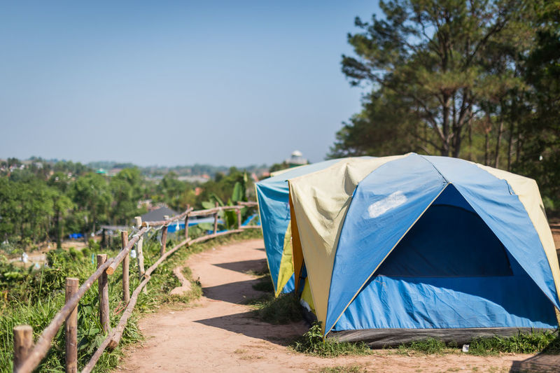 Scenic view of tent against clear blue sky
