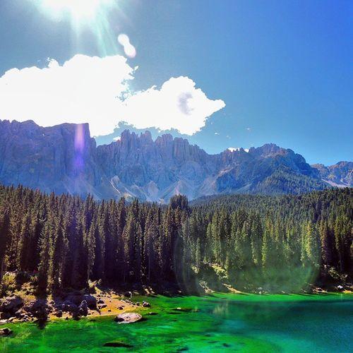 Riflessi.. Lagodicarezza Lake Karersee NovaLevante Bolzano Trentino AltoAdige mountain Latemar bluesky lightblue green water sun summer2014 instagramers instaphoto instalove instagood io&te