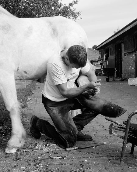 Outdoors Blackandwhitephotography Hard At Work Farrier Horse Shoe One Man At Work Kneeling Down Stables