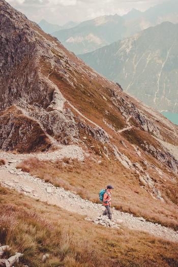Full length of man hiking on mountain
