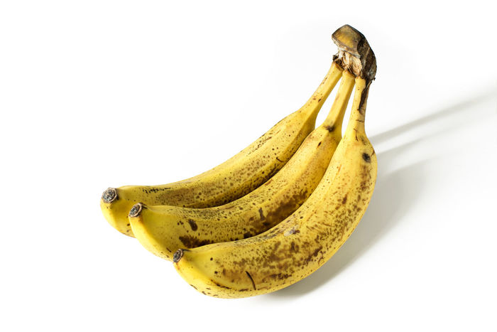 Bunch of three very ripe bananas isolated on white Snack Sugar Vitamins Banana Banana Peel Close-up Cooking Ingredient Cooking Ingredients Food Food And Drink Food Preparation Form Above Freshness Fruit Healthy Eating Over Ripe Potassium Ripe Studio Shot Sweet White Background Yellow