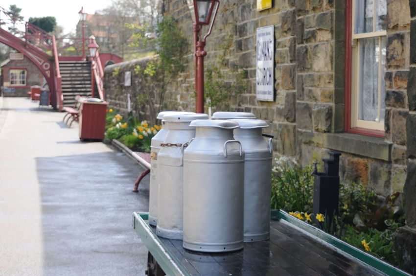 Vintage milk churns on Goathland Station Architecture Bridge Building Exterior Built Structure Day Delivery England Europe Milk Milk Churn No People Outdoors Platform Railway Railway Station Victorian Vintage Yorkshire