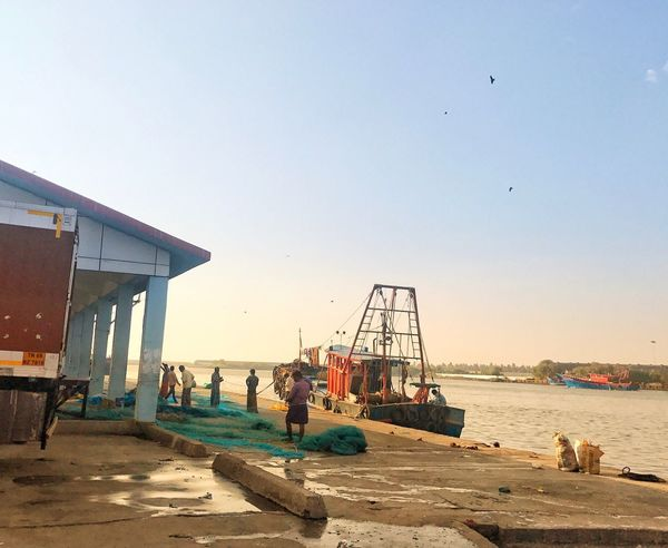 Harbour Sea Dailylife Fishingboat Fishermen Fishing Beach Clear Sky Real People Bird Sand Sunset Men Water Built Structure Sky People Nature Sea EyeEmNewHere