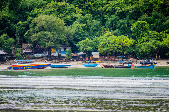 Beauty In Nature Day Green Color Growth Incidental People Inflatable  Land Mode Of Transportation Moored Multi Colored Nature Nautical Vessel Outdoors Plant River Tranquility Transportation Tree Water