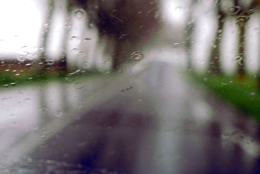 Backgrounds Day Diminishing Perspective Drop Mode Of Transport No People Rain Rainy Season Season  The Way Forward Weather Wet Windshield Defocused Season  Road Droplet Rainy Road Selective Focus View Through My Windshield Water