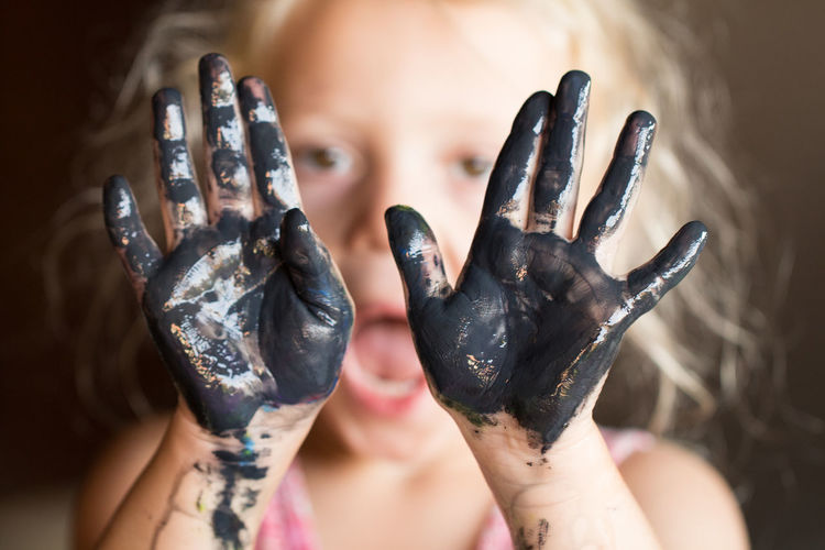 Front View Of Girl  Holding Up Dirty Hands