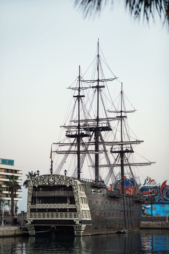 """Alicante, Spain- February 24, 2016: Ship """"Santisima Trinidad"""" in the port of Alicante. Ship is an exact replica of the """"Santisima Trinidad"""". It took over 2 years to build and cost more than 4 million Euros. Costa Blanca. Spain Alicante, Spain Costa Blanca Day Docked Ship Evening Famous Place Galleon Harbor History Landmark Mast Mediterranean Sea Moored Ship Nautical Vessel Old-fashioned Outdoors Port Promenade Replica  Retro Styled Santisima Trinidad Ship SPAIN Tourist Attraction  Travel Destinations"""