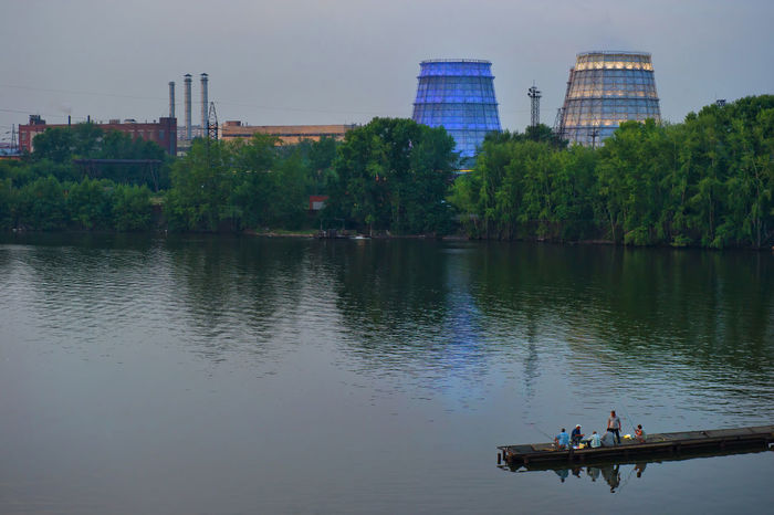 Beauty In Nature City City Life Day Growth Leisure Activity Lifestyles Medium Group Of People Nature Outdoors Rippled River Scenics Sky Tranquil Scene Tranquility Tree Unrecognizable Person Water