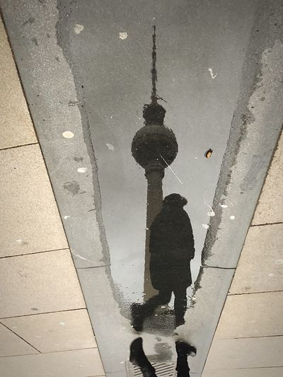 Real People City Street Puddle Wet Lifestyles Water Architecture Reflection Unrecognizable Person Walking One Person